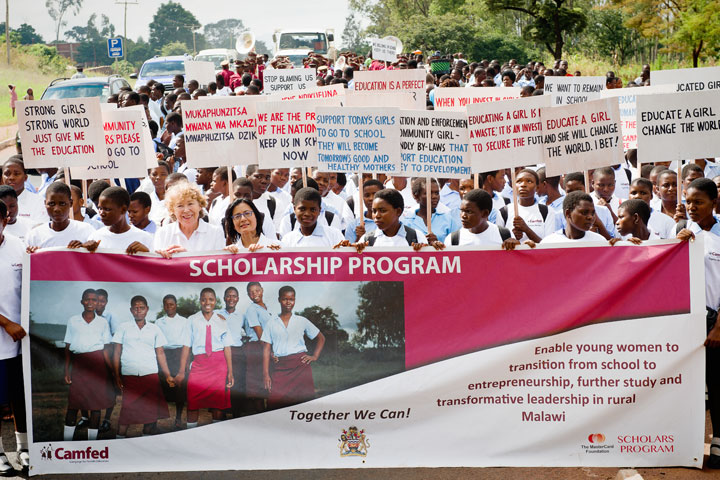 Malawian students and their communities celebrate the launch of the 10-year partnership