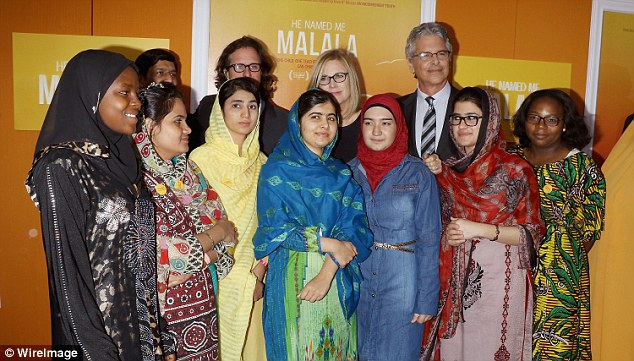CAMA members stand with Malala at her movie premiere in New York